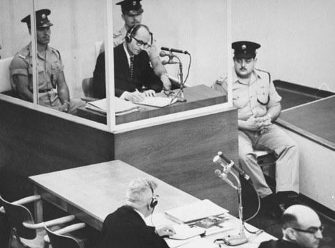 Adolf_Eichmann_takes_notes_during_his_trial_USHMM_65268.jpg